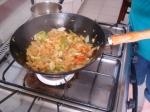 Frying a hot pan of salt fish.